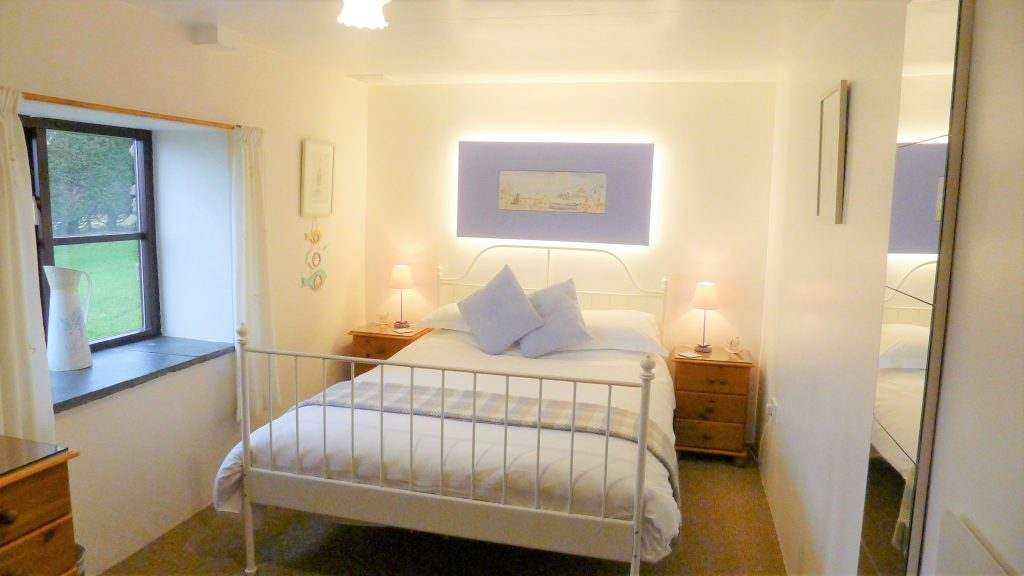 double-bedroom-with-feature-headboard-light